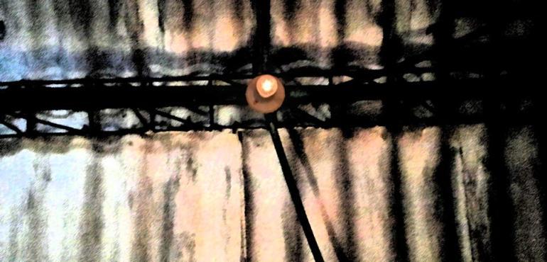 Image description: A single light bulb on the ceiling