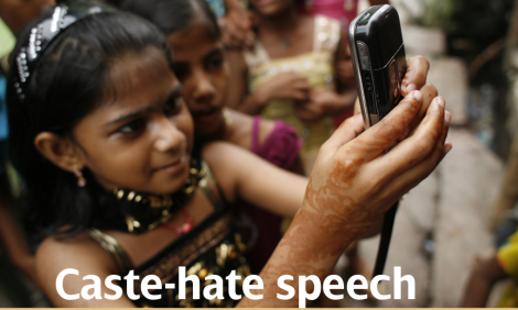 Dalit girl holding a phone to take a photo