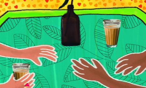 Two pairs of hands holding cups of chai