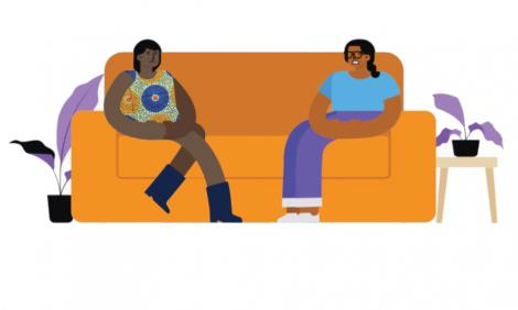 two women talking in a couch