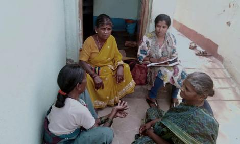Parijatha interviewing a group of domestic workers.