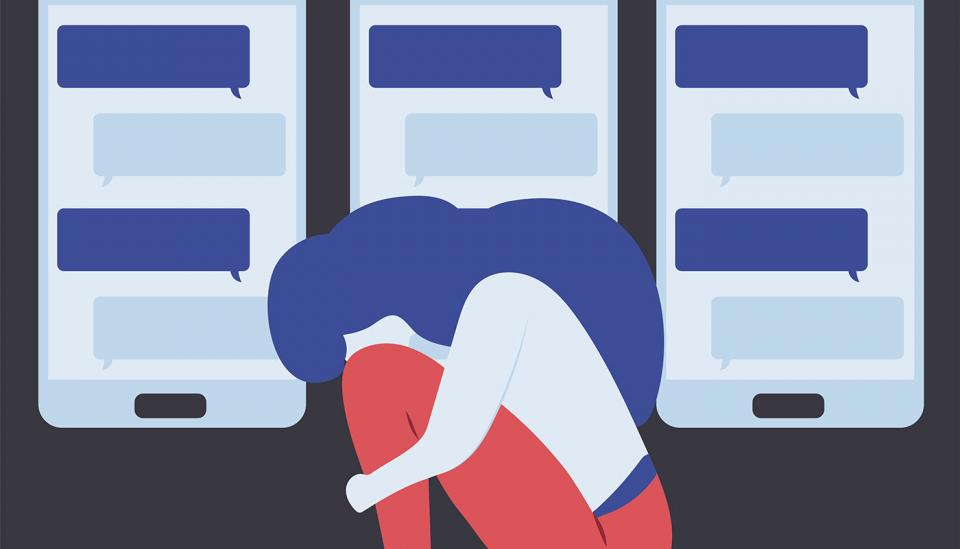 A woman cries hiding her face. In her back, a wall of screens with messages