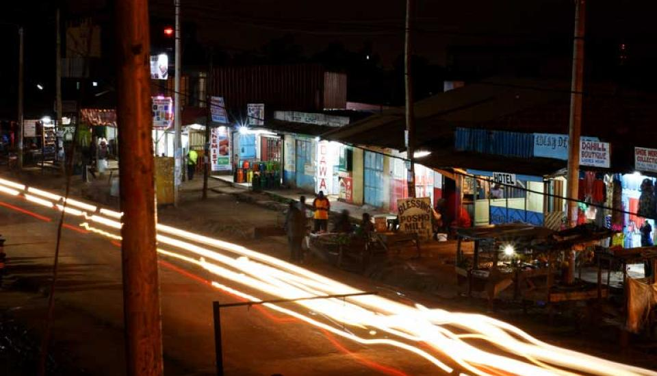 Image description: Road and shops in Kenyan city