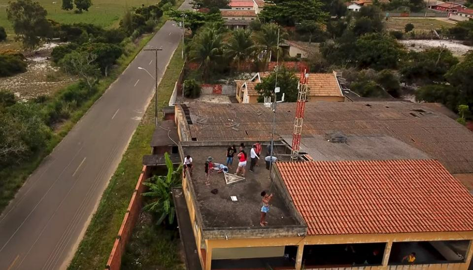 people installing a community antenna in a roof