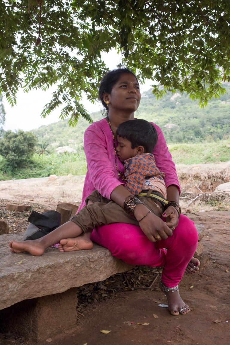 Siddava holding child on her lap